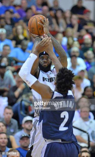 JaKarr Sampson of the Sacramento Kings shoots against Kobi Simmons of the Memphis Grizzlies during the 2017 NBA Summer League game at the Cox...
