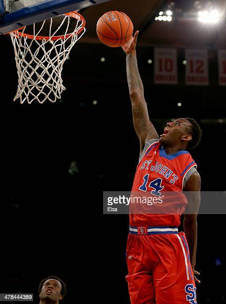 Jakarr Sampson of the St John's Red Storm heads for the net in the first half the Providence Friars during the quarterfinals of the Big East...