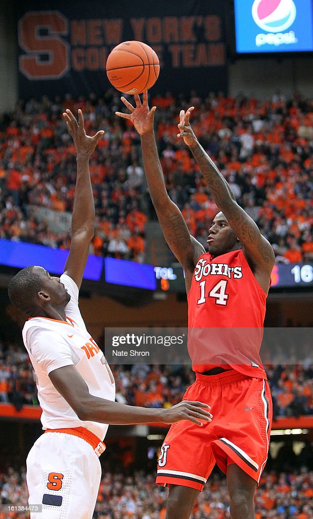 Jakarr Sampson #14 of the St. John's Red Storm shoots the ball against Baye Moussa Keita #12 of the Syracuse Orange during the game at the Carrier Dome on February 10, 2013 in Syracuse, New York.