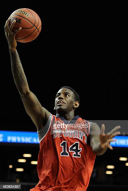Jakarr Sampson of the St John's Red Storm takes a shot against the Georgia Tech Yellow Jackets during the second half of their consolation game of...