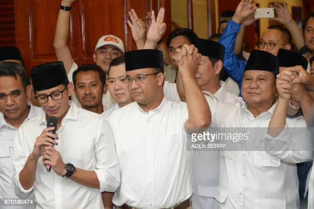 Jakarta governorelect Anis Baswedan his deputy governorelect Sandiaga Una and Prabowo Subianto of the Gerindra party hold hands together during a...