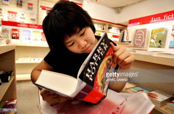 A fan reads a copy of the new Harry Potter novel inside a bookshop soon after she bought it in Jakarta 21 July 2007 The wait was finally over for...