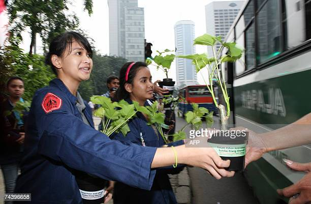 Students distribute free plants to mark the World Environment Day in Jakarta 05 June 2007 Indonesia is particularly vulnerable to the impact of...