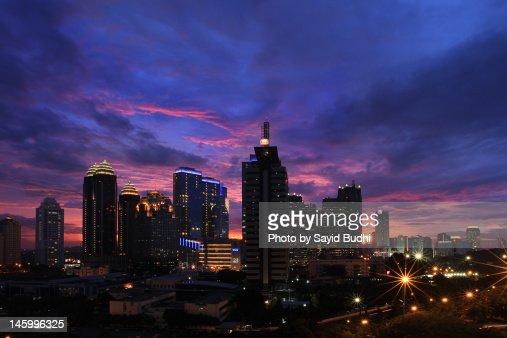 Jakarta under sunset sky : Stock Photo