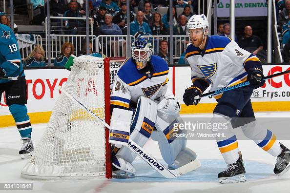Jake Allen and Carl Gunnarsson of the St Louis Blues defend the net against the San Jose Sharks in Game Four of the Western Conference Finals during...