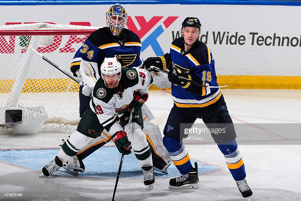 Jake Allen and Jay Bouwmeester of the St Louis Blues defend against Jason Pominville of the Minnesota Wild in Game Two of the Western Conference...