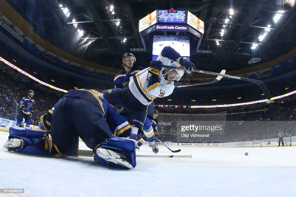 Jake Allen #34 and Jay Bouwmeester #19 of the St. Louis Blues defend against Viktor Arvidsson #38 of the Nashville Predators in Game Two of the Western Conference Second Round during the 2017 NHL Stanley Cup Playoffs at the Scottrade Center on April 28, 2017 in St. Louis, Missouri.