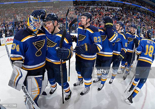 Jake Allen and Paul Stastny of the St Louis Blues celebrate after defeating the Chicago Blackhawks and clinching the Central Division on April 9 2015...