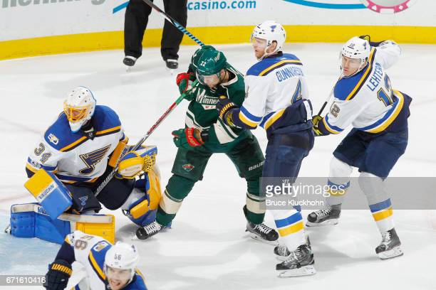 Jake Allen Carl Gunnarsson and Jori Lehtera of the St Louis Blues defend against Nino Niederreiter of the Minnesota Wild in Game Five of the Western...