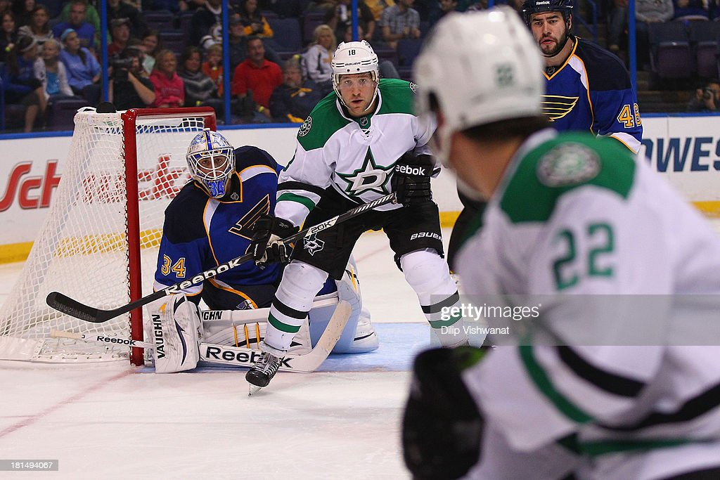 Jake Allen #34 of the St. Louis Blues and Alex Chiasson #12 of the Dallas Stars keep their eyes on the puck during a preseason at the Scottrade Center on September 21, 2013 in St. Louis, Missouri.