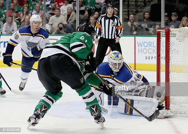 Jake Allen of the St Louis Blues blocks a shot against Antoine Roussel of the Dallas Stars in the first period at American Airlines Center on March...