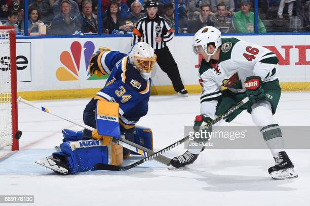 Jake Allen of the St Louis Blues blocks a shot from Jared Spurgeon of the Minnesota Wild in Game Three of the Western Conference First Round during...