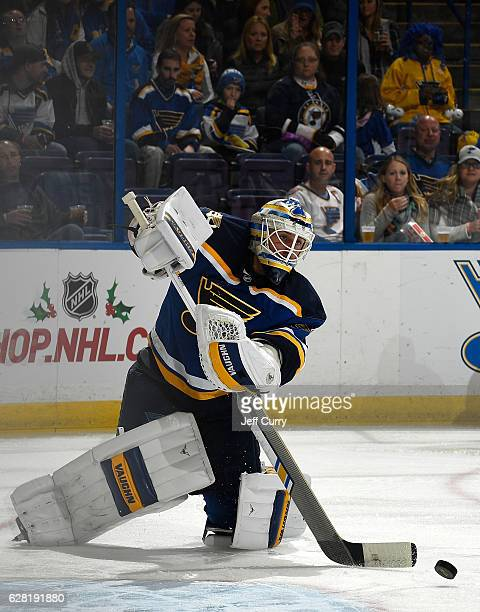 Jake Allen of the St Louis Blues clears the puck against the Minnesota Wild on November 26 2016 at Scottrade Center in St Louis Missouri