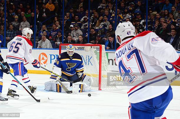 Jake Allen of the St Louis Blues defends the net against Alexander Radulov of the Montreal Canadiens on December 6 2016 at Scottrade Center in St...