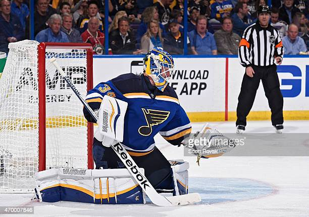 Jake Allen of the St Louis Blues makes a glove save against the Minnesota Wild in Game One of the Western Conference Quarterfinals during the 2015...