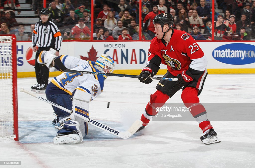 Jake Allen of the St Louis Blues makes a save against a shorthanded breakaway by Chris Neil of the Ottawa Senators at Canadian Tire Centre on March 1...