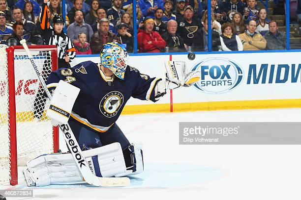 Jake Allen of the St Louis Blues makes a save against the Los Angeles Kings at the Scottrade Center on December 16 2014 in St Louis Missouri