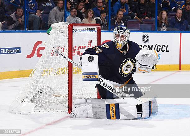 Jake Allen of the St Louis Blues makes a save against the Minnesota Wild on October 31 2015 at Scottrade Center in St Louis Missouri