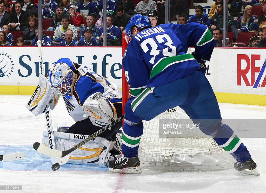 Jake Allen #34 of the St. Louis Blues makes a save off the shot of Henrik Sedin #33 of the Vancouver Canucks during their NHL game at Rogers Arena March 19, 2013 in Vancouver, British Columbia, Canada. Vancouver won 3-2.