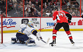 Jake Allen of the St Louis Blues makes a stick save against Ryan Dzingel of the Ottawa Senators in the second period during an NHL game at Canadian...