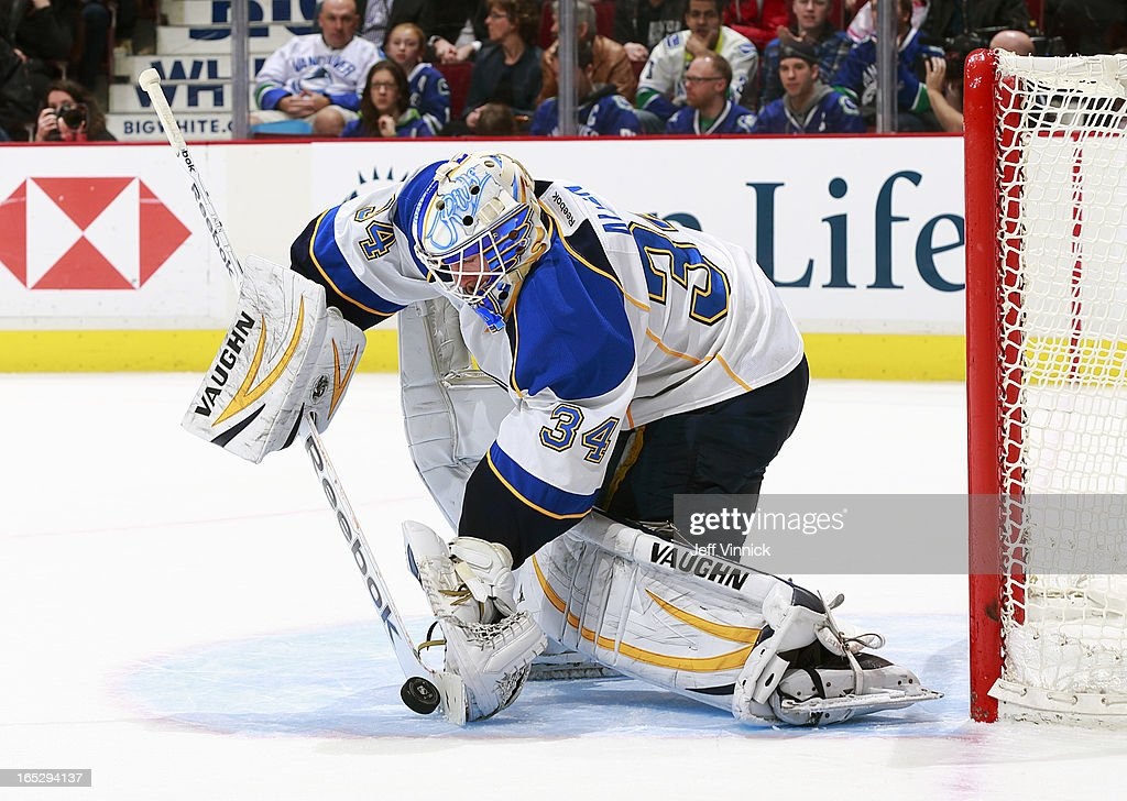 Jake Allen #34 of the St. Louis Blues makes a stick save during an NHL game against the Vancouver Canucks at Rogers Arena March 19, 2013 in Vancouver, British Columbia, Canada.