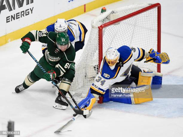 Jake Allen of the St Louis Blues makes a stickside save against a shot by Mikael Granlund of the Minnesota Wild during the overtime period in Game...