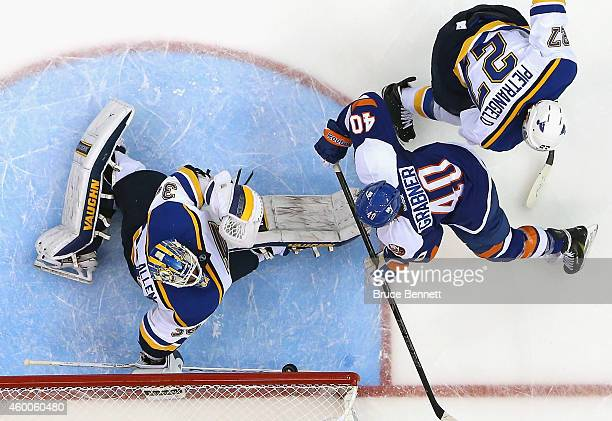 Jake Allen of the St Louis Blues makes the first period save on Michael Grabner of the New York Islanders at the Nassau Veterans Memorial Coliseum on...