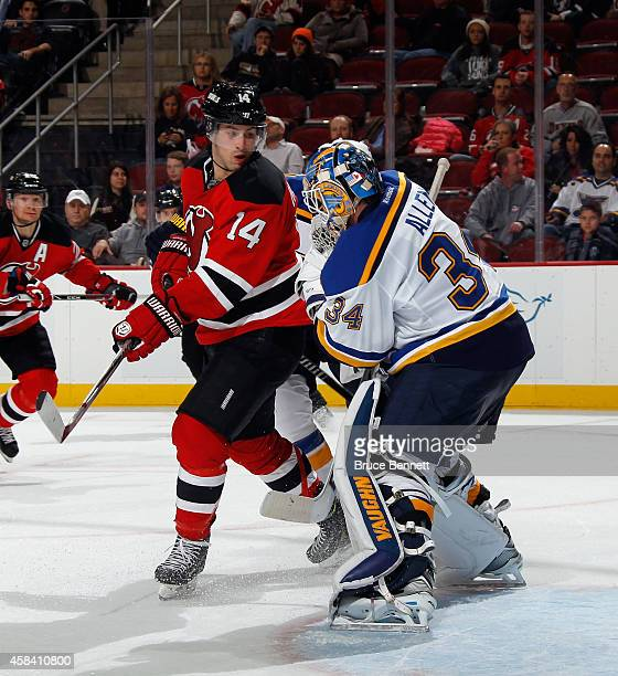 Jake Allen of the St Louis Blues makes the second period save as Adam Henrique of the New Jersey Devils looks for the rebound at the Prudential...