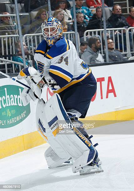 Jake Allen of the St Louis Blues passes the puck against the San Jose Sharks during an NHL game on December 20 2014 at SAP Center in San Jose...