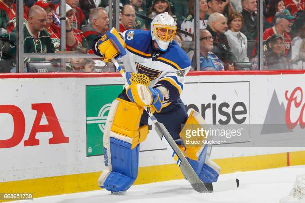 Jake Allen of the St Louis Blues passes the puck against the Minnesota Wild in Game Two of the Western Conference First Round during the 2017 NHL...