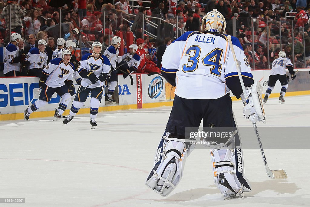 Jake Allen #34 of the St Louis Blues skates towards his teammates after the Blues won in overtime 4-3 during a NHL game against the Detroit Red Wings at Joe Louis Arena on February 13, 2013 in Detroit, Michigan.