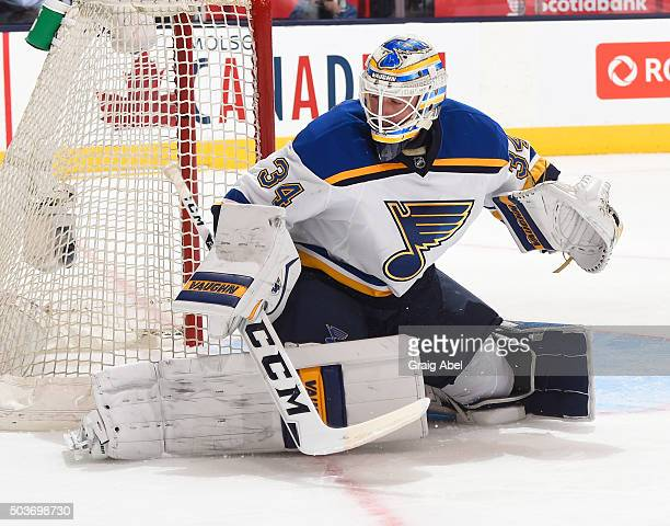 Jake Allen of the St Louis Blues stops a shot against the Toronto Maple Leafs during game action on January 2 2016 at Air Canada Centre in Toronto...