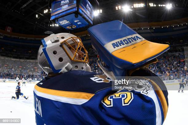 Jake Allen of the St Louis Blues takes a drink during warmups prior to a game against the Minnesota Wild in Game Three of the Western Conference...