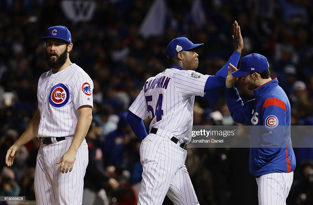 Jake Arrieta #49 (L) and Aroldis Chapman #54 of the Chicago Cubs celebrate after beating the Cleveland Indians 3-2 in Game Five of the 2016 World Series at Wrigley Field on October 30, 2016 in Chicago, Illinois.