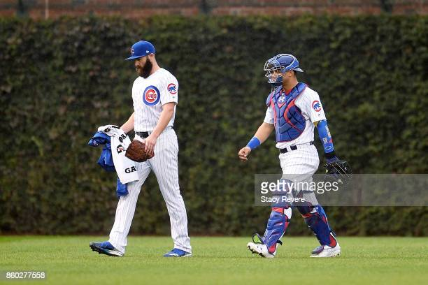 Jake Arrieta and Willson Contreras of the Chicago Cubs walk across the field before game four of the National League Division Series against the...