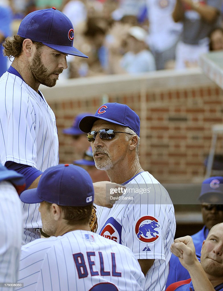 <a gi-track='captionPersonalityLinkClicked' href=/galleries/search?phrase=Jake+Arrieta&family=editorial&specificpeople=5437045 ng-click='$event.stopPropagation()'>Jake Arrieta</a> (L) is greeted after leaving the game against the Philadelphia Phillies during the sixth inning of the Chicago Cubs on September 1, 2013 at Wrigley Field in Chicago, Illinois.