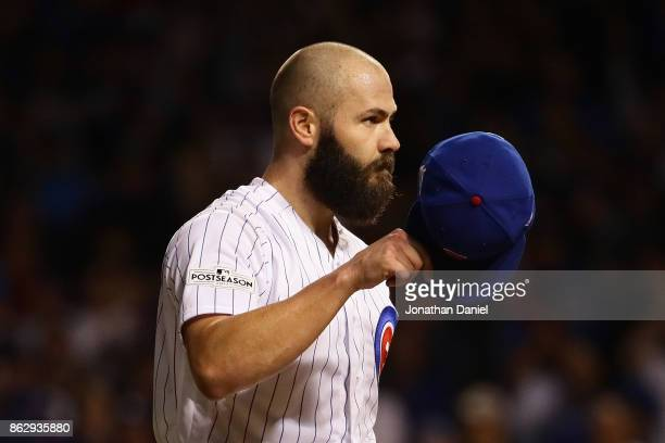 Jake Arrieta of the Chicago Cubs acknowledges the crowd after being relieved in the seventh inning against the Los Angeles Dodgers during game four...