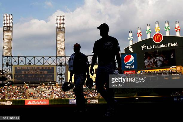 Jake Arrieta of the Chicago Cubs and David Ross walk to the dugout before the game against the Chicago White Sox at US Cellular Field on August 15...