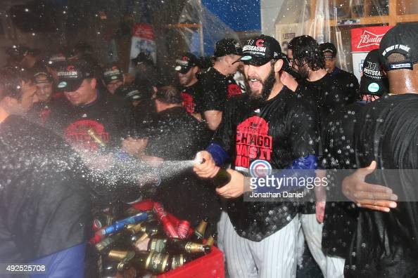 Jake Arrieta of the Chicago Cubs celebrates in the clubhouse after defeating the St Louis Cardinals in game four of the National League Division...