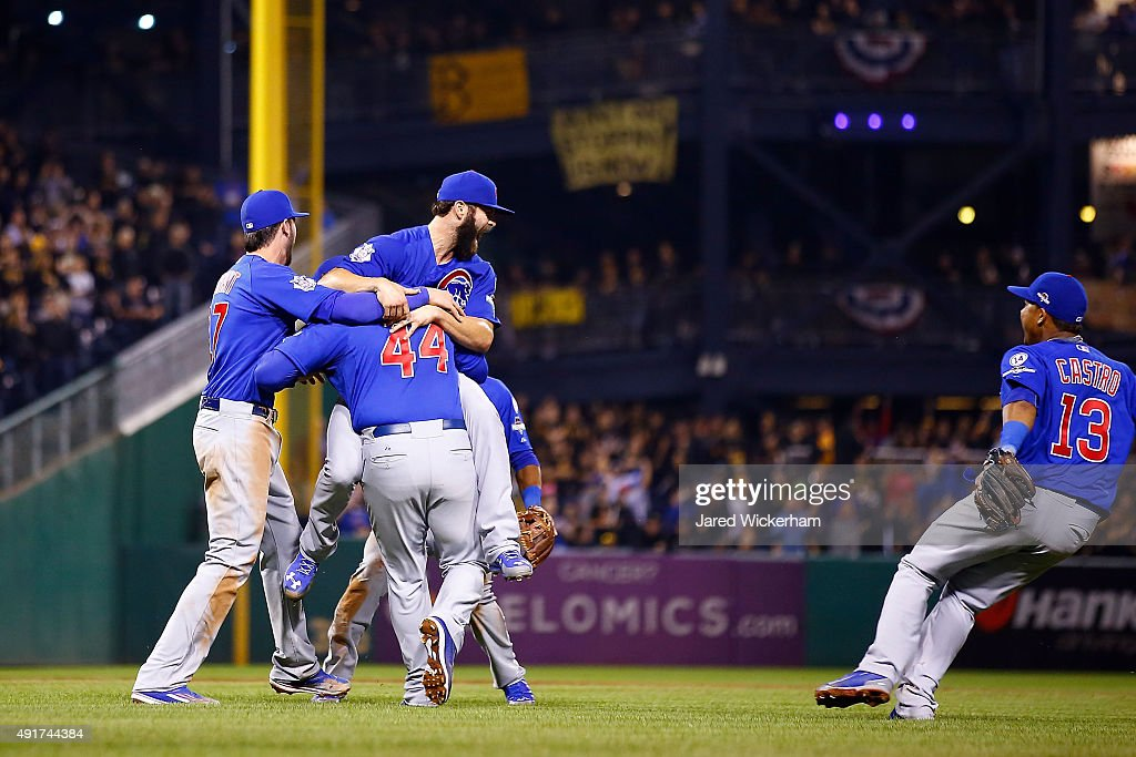 Jake Arrieta #49 of the Chicago Cubs celebrates with Anthony Rizzo #44 of the Chicago Cubs, Kris Bryant #17 of the Chicago Cubs and Starlin Castro #13 of the Chicago Cubs after defeating the Pittsburgh Pirates to win the National League Wild Card game at PNC Park on October 7, 2015 in Pittsburgh, Pennsylvania. The Chicago Cubs defeated the Pittsburgh Pirates with a score of 4 to 0.