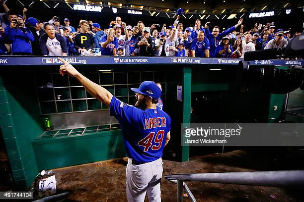 Jake Arrieta of the Chicago Cubs celebrates with fans after defeating the Pittsburgh Pirates to win the National League Wild Card game at PNC Park on...