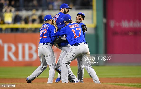Jake Arrieta of the Chicago Cubs celebrates with teammates after defeating the Pittsburgh Pirates 40 in the National League Wild Card Game on...