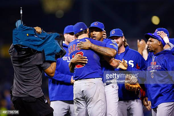 Jake Arrieta of the Chicago Cubs celebrates with teammates after defeating the Pittsburgh Pirates to win the National League Wild Card game at PNC...
