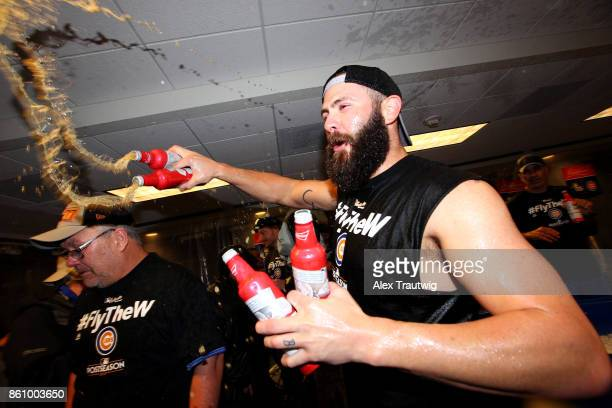 Jake Arrieta of the Chicago Cubs celebrates with teammates in the clubhouse after winning Game 5 of the National League Division Series 98 against...