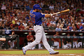 Jake Arrieta of the Chicago Cubs hits a tworun home run against the Arizona Diamondbacks during the second inning of the MLB game at Chase Field on...
