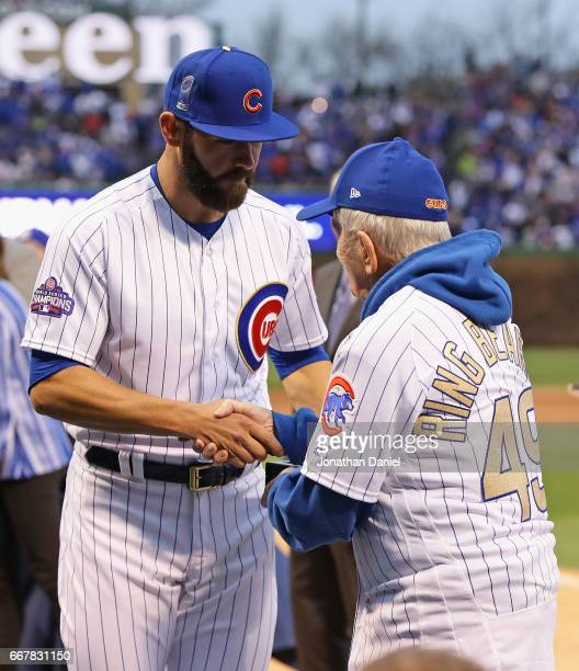 Jake Arrieta of the Chicago Cubs is presented his World Series ring by fan Jimmy Thurman of Kewanee Illinois during a ceremony before a game against...