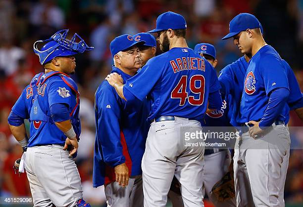 Jake Arrieta of the Chicago Cubs is pulled by manager Rick Renteria after giving up his one and only hit in the eighth inning to Stephen Drew of the...