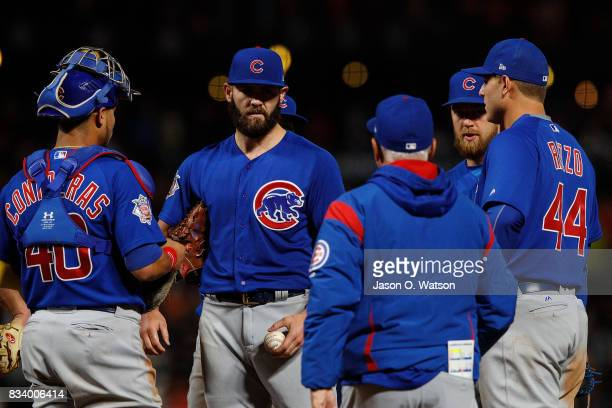 Jake Arrieta of the Chicago Cubs is relieved by manager Joe Maddon during the seventh inning against the San Francisco Giants at ATT Park on August 7...