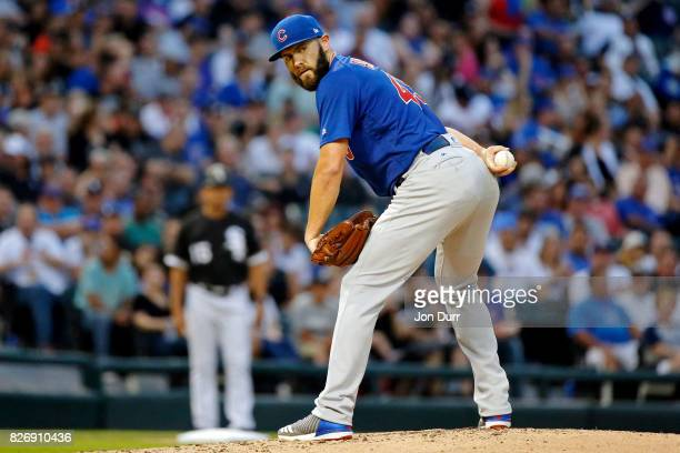 Jake Arrieta of the Chicago Cubs looks at first base before throwing a pitch against the Chicago White Sox during the first inning at Guaranteed Rate...