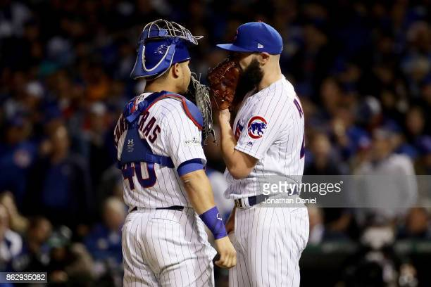Jake Arrieta of the Chicago Cubs meets with Willson Contreras in the seventh inning against the Los Angeles Dodgers during game four of the National...